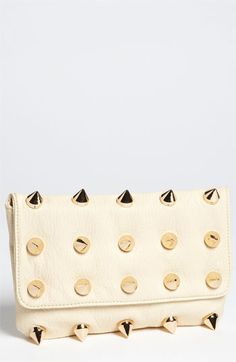 my punk rock background bubbles to the surface every now and then. love a good spike stud clutch...