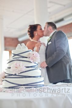 navy blue ribbon wedding cake with pale pink peonies - St. Louis Photographer | Michelle Schwartz Photography | Wedding |    http://michelleschwartz.zenfolio.com/