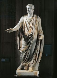 Rome Toga costume. Marble statue of Emperor Tiberius (14-37 a.d.) wearing toga, frome Rome, Vatican Hill