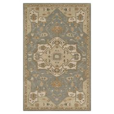 Anchor your living room seating group or define space in the den with this hand-tufted wool rug, featuring a Persian-inspired motif for classic style.