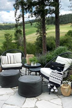 """Black wicker pops against your sunshine-y porch, while a lily white cushion keeps this Aeri feeling more """"Cruella de Fashion"""" than """"Morticia Adams."""" Photo by Our PNW Home. #OutdoorDecor #PatioFurniture #LoungeChair Morticia Adams, Modern Farmhouse Plans, High Quality Furniture, Lounge Chairs, Wicker, Porch, Sunshine, Cushion, Sweet Home"""