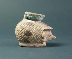 Ancient Egyptian faience cosmetics vase shaped like a hedgehog.