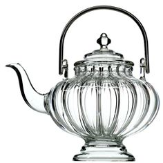 Sikkim teapot. handblown glass by a French master glassmaker. silver-plated handle.
