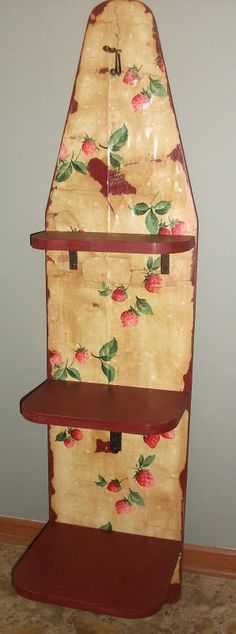 BERRY NICE - hanging shelves fashioned from a vintage wooden ironing board, with antique strawberry wallpaper, berry red paint, and vintage brackets. SOLD!
