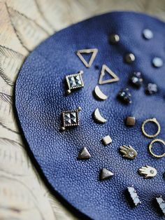 ($68, in color hamsa, celestial, neutral geo, or cobalt) Mega Stud Set | Stones, gems, and charms! These sweet studs come in quite a collection, displayed on a leather patch. Mix and match as you like.   *By Free People