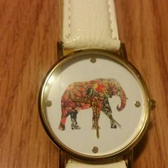 White elephant watch Cute white elephant watch, never worn, only tried on once. I just never where it and need more space in my closet Accessories Watches