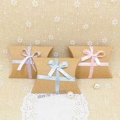 $0.30// Favor Boxes with Ribbon// Ribbon available in pink, blue, or purple// Delivery: 2-4 weeks