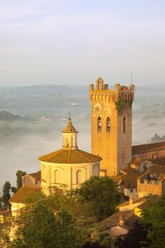 Misty dawn over San Miniato, Tuscany. Near Florence, Italy
