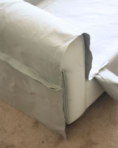 How to make slipcovers - covering a sofa frame. A step by step detailed tutorial on how to make slipcovers.