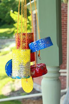 Painting tin cans to make a wind chime