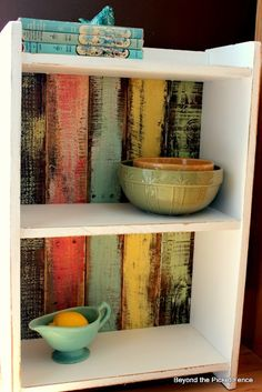 Cheap shelf, remove pressboard and replace with painted pallet wood. Love the colors :]