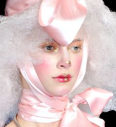 Airbrushed porcelain doll-inspired makeup at John Galliano S/S 2009