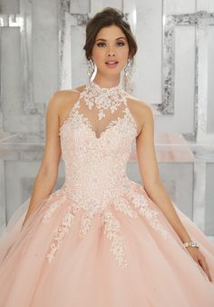 Classic and Feminine, this Quinceañera Ballgown Features a Lace Bodice Accented with Delicate Beading. A Full Tulle Skirt and Keyhole Corset Back Complete the Look. Matching Bolero Jacket Included. Colors Available: Blush, Tropical Turquoise, White.