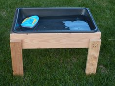 DIY Water Table - I never thought of buying one before, and now that he's almost 4 I can't justify paying good money for him to use it just one summer (at 5 he may think it's babyish.)  But this would make sense if I can get someone to help...and keep it under $20 or so...  :)