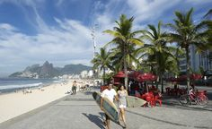 """""""Young Brazilian surfers walk with their boards towards Arpoador, a popular surf spot."""""""