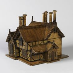 House Model Tea Caddy, ca. 1870 Various woods. Gift of Eugene V. and Clare E. Thaw. // Tea caddy in the form of a nineteenth century Gothic-Tudor style half-timbered house with numerous chimneys, the roof lifting to reveal 2 tea caddies and one glass mixing bowl. //  - Maria Elena Garcia -  ► www.pinterest.com/megardel/ ◀︎