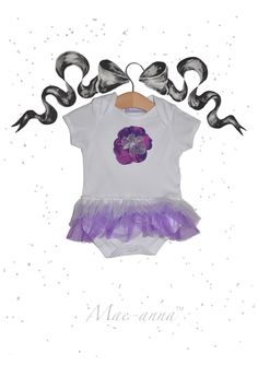 Ombre Mae-anna babygrow tutu, handmade in the UK. Purple layers of tulle and a shimmery satin detachable flower. Adorable for baby girls/ toddlers.