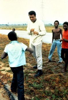 "<b>Ali during the filming of <em>When We Were Kings</em> in Zaire, 1974</b><br><br> <b>Leon Gast:</b> ""I watched the first-ever televised heavyweight championship fight in 1946, between Joe Louis and Billy Conn, at my uncle Billie's house in Jersey City, N.J. From that early experience I became a lifelong boxing fan. Ten years later I moved to New York City, just eight blocks from St. Nick's Boxing Arena on 66th St. — a smoky, small venue — where I saw some of the greatest fighters of the…"