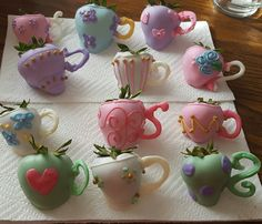 Candy coated strawberries decorated like teapots.