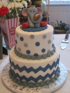 "Chevron and polka-dots baby shower cake with a handmade elephant complete with ""red socks""! Cake by Cutting Edge Cakes of Oklahoma City, OK"