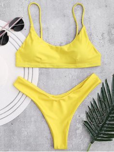 AD : Padded Adjusted Cami Thong Bikini - YELLOW Swimwear Type: Bikini Bikini Type: Flounce Bikini Gender: For Women Material: Chinlon Bra Style: Padded Support Type: Wire Free Collar-line: Spaghetti Straps Pattern Type: Solid Color Waist: Natural Elasticity: Elastic Weight: 0.2200kg Package: 1 x Bra 1 x Briefs