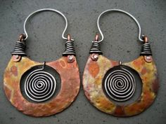 For these ethnic, organic looking earrings I used a combination of copper and sterling silver. Through heat the copper transformed into this