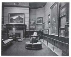 James J. Hill House Picture Gallery in 1922, looking east toward the fireplace. That funky chair straight ahead is a Victorian-era Poof or Borne Settee. It was originally French and used as a conversation chair. See http://ancientpoint.com/category/265-antiques_furniture_chairs_1800_1899_/index.html and http://victorianfurnitureco.com for more Victorian furniture.