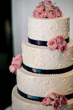 pink and blue wedding cake; photo: Melani Lust Photography
