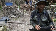 A cage made of barbed wire and bamboo sticks that Malaysian police said was used to hold migrants is seen at the abandoned human trafficking camp in the jungle close the Thailand border at Bukit Wang Burma in northern Malaysia. Thailand has indicted 72 human traffickers!