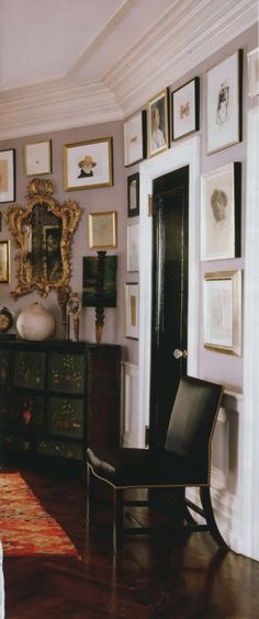 Kate Spade's NYC Apartment - Love the Black Door with White Trim and Pretty Hardware and tons of art to adore.