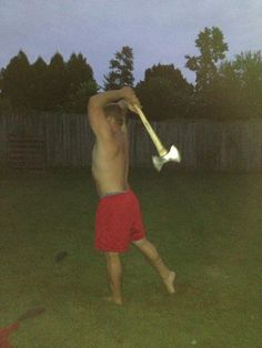 Kenny throwing Sarah's ax in the backyard in Raleigh... July 2013