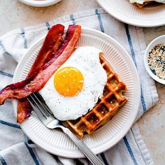 Everything Bagel Waffles With Cheddar Centers And Topped With Bacon And Eggs. Get this and 60+ more Breakfast Eggs recipes at https://feedfeed.info/breakfasteggs