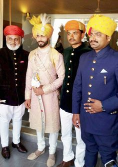 Sir Ravindra Jadeja tied the knot with his fiancée Rivaba Solanki on April 2016 in Rajkot in a traditional royal Rajput fashion. Mens Indian Wear, Mens Ethnic Wear, Indian Groom Wear, Indian Men Fashion, Wedding Dresses Men Indian, Wedding Dress Men, Wedding Attire, Sherwani Groom, Wedding Sherwani