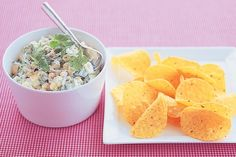 Invite some friends over to watch the football and pass around a platter with corn chips and this zesty corn dip.