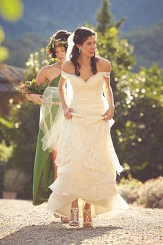 Vintage lace and pleating with a drape off the shoulders to soften the look - adore this look!   Photo by: Italian Wedding Photography By Jules