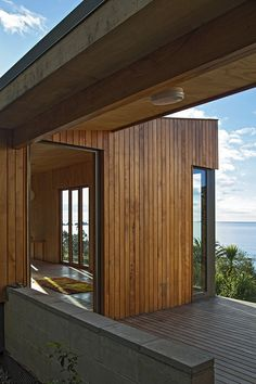 Modern prefab New Zealand beach house interior and deck space