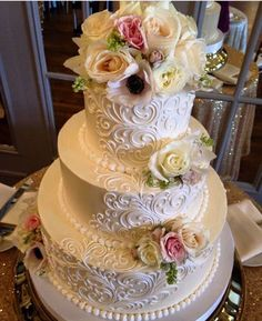 Classic Elegant Scrolling-3 tier buttercream wedding cake with fresh flowers