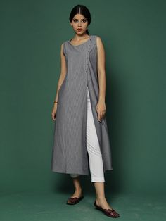 Description: Yarn dyed pin striped kurta with metal buttons. It has an open front placket. Pair it up with off white palazzos or pants. Size Chart (In inches) -