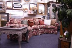 This couch is comfortable and has room for company. Originally custom made here in town at By Design, you know its a quality piece.