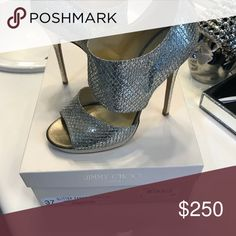 Jimmy choo shoes Glitter glitter glitter.   These sparkle from across the room. Wore them 2 times. Size 8. I paid 950.00 for them. Jimmy Choo Shoes Heels