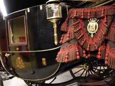 A Berlin (or Berline) carriage was a type of covered, fast and light, four-wheeled, travelling carriage with two interior seats and a separate hooded rear seat for a footman, detached from the body. It had a distinctive two-perch running gear and thoroughbrace suspension, with the body hung high between the perches by shafts to leather braces. See http://en.wikipedia.org/wiki/Berlin_%28carriage%29