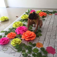 Oh of course....lay down the giant board then put the flowers on, the raise the board...