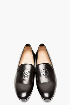 ALEXANDER MCQUEEN Black leather skull-embossed loafers