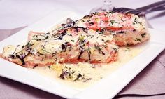 Baked salmon with sauce of herbs.