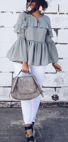 Sage Green Blouse with lots 'o ruffles.  Add a pair of white skinnys (I have a pair of #OldNavy that fit like jeans I have at higher price points.  Add a grey tote, white statement necklace, &  white Adidas tennis shoes or heeled sandals--it's a great work week ensemble!
