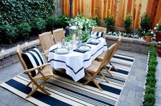scot meachm blue and white dinner party outdoor dining room teak furniture patio table chairs stripe rug design ideas for home Patio Dining, Patio Table, Outdoor Dining, Outdoor Tables, Dining Area, Dining Table, Patio Rugs, Wood Patio, Outdoor Seating