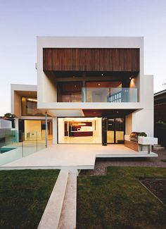 Contemporary, white home with wood inlay. #contemporary #architecture luxuryprivatelistings.com Call us today at 480-285-2782 or visit Luxuryprivatelistings.com