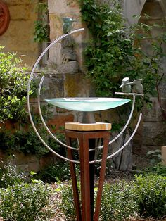 Glass dish birdbath with three bronze kingfishers in a double loop on a corten steel plinth (not available with a stone plinth)