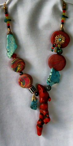 Natural stone necklace created using turquoise, handcrafted beads by Alyssa, and a variety of other interesting beads and findings. This necklace was created by Alyssa and Barb's collaboration.