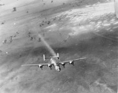 """Returning from Vienna, Austria, B-24H Liberator """"Scrappy"""" with the 725th Bomb Squadron trails smoke and is losing altitude east of Zagreb, Yugoslavia, 22 Aug 1944. The plane crashed near Zdenci, Yugoslavia"""